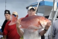Cary Town, a Navy corpman with the Wounded Warrior East Battalion of Camp Lejeune shows his 27 pound red snapper he caught on board the Continental Shelf during Fridays' fishing trip, September 21, 2007.  Chuck Beckley  003
